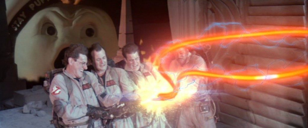 A scene from the 1984 film showing four members of the Ghostbusters defeating Gozer by crossing the streams from their proton packs.